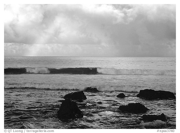 Rainbow and boulders, Siu Point, Tau Island. National Park of American Samoa (black and white)