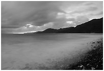 Approaching storm at sunrise, Vatia bay, Tutuila Island. National Park of American Samoa ( black and white)
