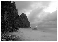 Peeble beach and Pola Island, stormy sunrise, Tutuila Island. National Park of American Samoa (black and white)