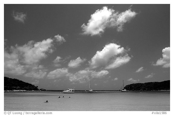 Saltpond bay beach with swimmers and boats. Virgin Islands National Park (black and white)