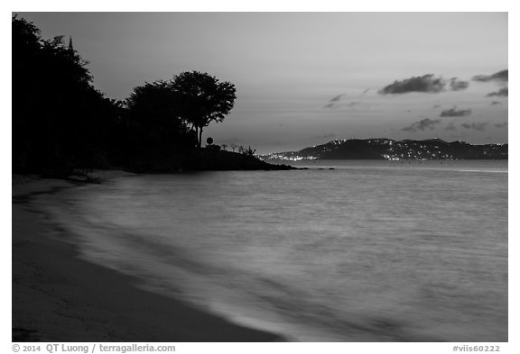 Honeymoon beach at dusk with lights of St Thomas. Virgin Islands National Park (black and white)