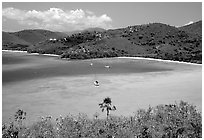 Turquoise waters in Francis Bay with anchored yacht. Virgin Islands National Park, US Virgin Islands. (black and white)