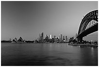 Harbour bridge, city skyline and opera house, dawn. Sydney, New South Wales, Australia (black and white)