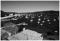 Yatchs anchored in the outskirts of the city. Sydney, New South Wales, Australia (black and white)