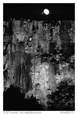 Rock climbing on the banks of the Brisbane River at night. Brisbane, Queensland, Australia (black and white)