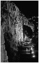 Rock climbing on the banks of the Brisbane River at night. Brisbane, Queensland, Australia ( black and white)