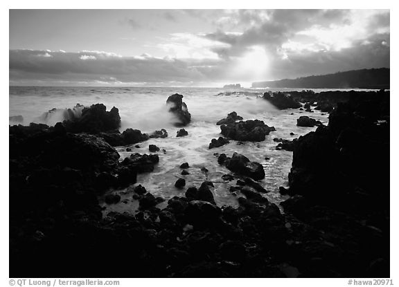 Rocks and surf at sunrise, Keanae Peninsula. Hawaii, USA (black and white)