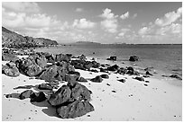 Volcanic rocks and beach, near Makai research pier,  early morning. Oahu island, Hawaii, USA (black and white)