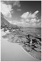 Beach and rocks near Makai research pier,  early morning. Oahu island, Hawaii, USA (black and white)