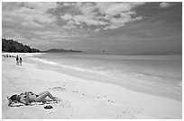 Woman sunning herself on Waimanalo Beach. Oahu island, Hawaii, USA (black and white)