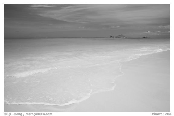 Waimanalo Beach and ocean with turquoise waters and off-shore island. Oahu island, Hawaii, USA (black and white)