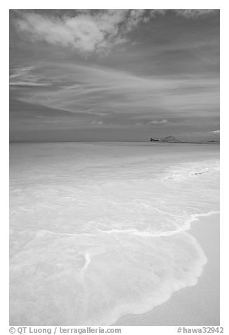 Foam, sand, and turquoise waters, Waimanalo Beach. Oahu island, Hawaii, USA (black and white)
