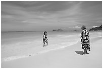 Two women, the Older in hawaiian dress, on Waimanalo Beach. Oahu island, Hawaii, USA (black and white)