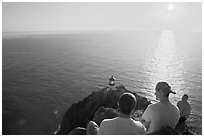 Men above the Makapuu head ligthouse, early morning. Oahu island, Hawaii, USA (black and white)