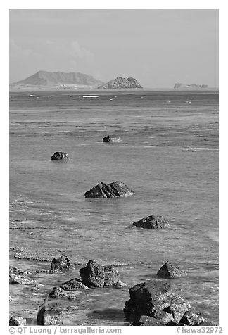 Rocks and turquoise waters near Makai research pier. Oahu island, Hawaii, USA (black and white)