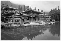 Byodo-In temple reflected in pond on a cloudy day. Oahu island, Hawaii, USA (black and white)