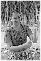 Tonga woman showing how to make cloth out of Mulberry bark. Polynesian Cultural Center, Oahu island, Hawaii, USA ( black and white)