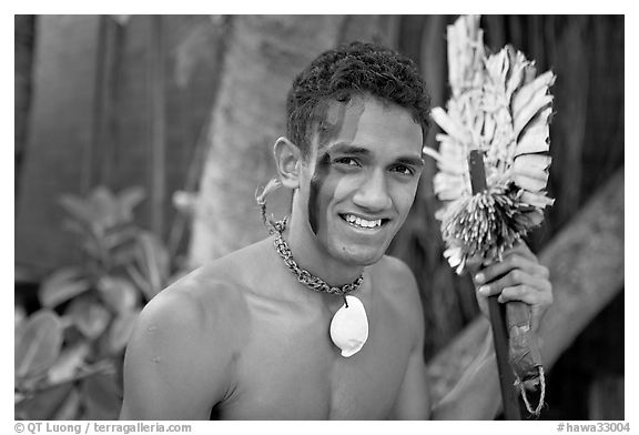 Fiji man with traditional face painting. Polynesian Cultural Center, Oahu island, Hawaii, USA (black and white)