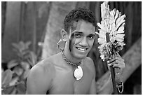 Fiji man with traditional face painting. Polynesian Cultural Center, Oahu island, Hawaii, USA ( black and white)