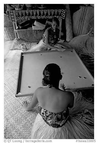Fiji women playing a traditional game similar to pool. Polynesian Cultural Center, Oahu island, Hawaii, USA (black and white)