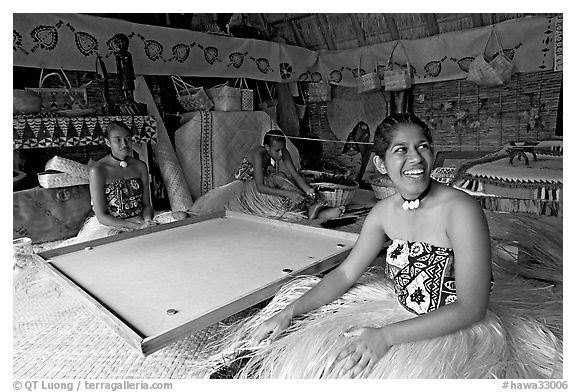 Fiji women sitting at a traditional pool table in vale ni bose (meeting) house. Polynesian Cultural Center, Oahu island, Hawaii, USA (black and white)