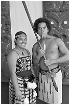 Maori woman and man sticking out his tongue. Polynesian Cultural Center, Oahu island, Hawaii, USA ( black and white)