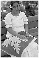 Woman making a traditional hawaiian quilt. Polynesian Cultural Center, Oahu island, Hawaii, USA ( black and white)