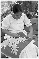 Woman quilting. Polynesian Cultural Center, Oahu island, Hawaii, USA (black and white)