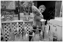 Woman preparing a cup of shave ice. Waikiki, Honolulu, Oahu island, Hawaii, USA (black and white)