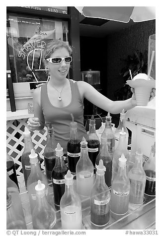 Woman handing out a cup of shave ice. Waikiki, Honolulu, Oahu island, Hawaii, USA (black and white)
