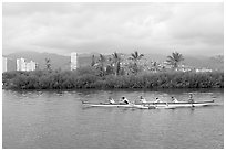 Outrigger canoe along the Ala Wai Canal. Waikiki, Honolulu, Oahu island, Hawaii, USA (black and white)
