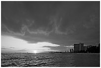 Sun setting and Honolulu skyline. Waikiki, Honolulu, Oahu island, Hawaii, USA (black and white)