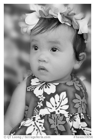 Black and white picture photo baby girl in hawaiian dress wearing a flower lei on her head waikiki honolulu oahu island hawaii usa