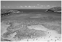 Hanauma Bay with people in water. Oahu island, Hawaii, USA (black and white)