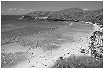 Hanauma Bay and beach with people. Oahu island, Hawaii, USA (black and white)