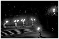Dance with fire performed by Samoans. Polynesian Cultural Center, Oahu island, Hawaii, USA ( black and white)