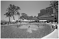 Swimming pool, Halekulani hotel. Waikiki, Honolulu, Oahu island, Hawaii, USA (black and white)