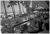 Beachside bar. Waikiki, Honolulu, Oahu island, Hawaii, USA (black and white)