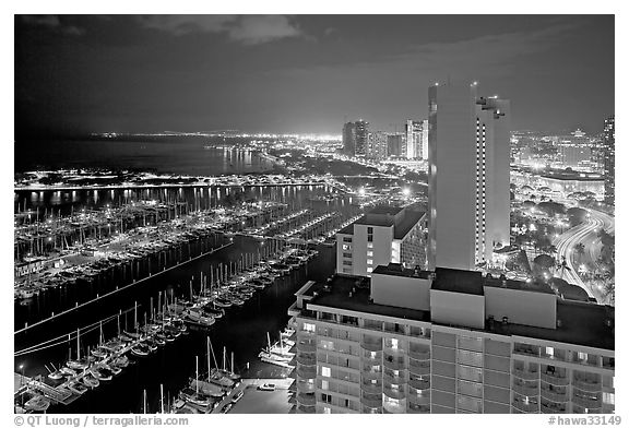 Ala Wai Yatch Harbor and skyline at night. Waikiki, Honolulu, Oahu island, Hawaii, USA