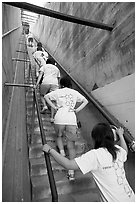 Women climbing a staircase on the Diamond Head summit trail. Oahu island, Hawaii, USA ( black and white)
