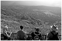 Tourists look at the  Diamond Head crater, early morning. Oahu island, Hawaii, USA ( black and white)