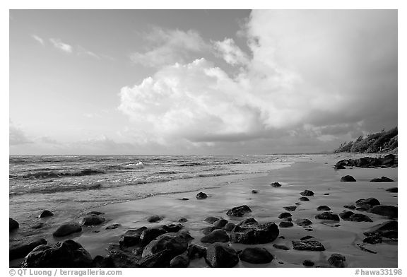 Boulders, beach and clouds, Lydgate Park, sunrise. Kauai island, Hawaii, USA (black and white)
