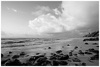 Boulders, beach and clouds, Lydgate Park, sunrise. Kauai island, Hawaii, USA ( black and white)