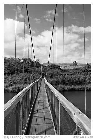 Wooden swinging bridge, Hanapepe. Kauai island, Hawaii, USA (black and white)