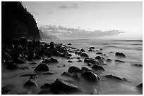Boulders, surf, and Na Pali Coast, Kee Beach, dusk. Kauai island, Hawaii, USA (black and white)