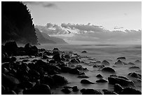 Boulders, surf, and Na Pali Coast, Kee Beach, dusk. Kauai island, Hawaii, USA ( black and white)