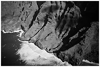 Aerial view of fluted mountains and surf, Na Pali Coast. Kauai island, Hawaii, USA (black and white)