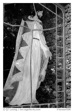 A stained glass with Jesus in traditional hawaiian robe, Palapala Hoomau church. Maui, Hawaii, USA (black and white)