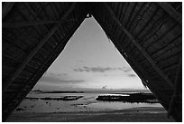 Aiopio fishtrap framed by Halau at dusk, Kaloko-Honokohau National Historical Park. Big Island, Hawaii, USA (black and white)
