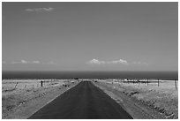 Road and Pacific Ocean, South Point. Big Island, Hawaii, USA (black and white)
